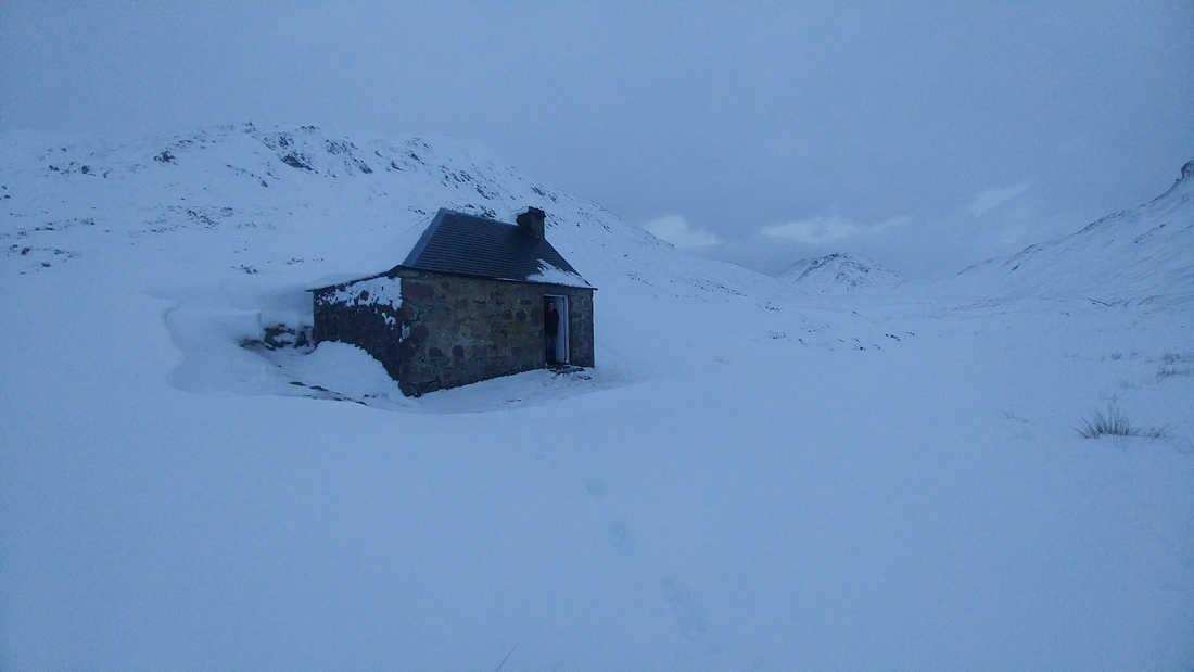 The Lairig Leacach Mountain Bothy in winter snow drifts